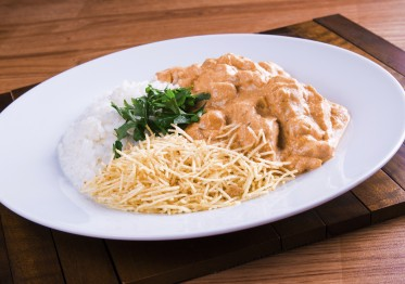 Chicken Stragonoff served with rice and straw potato fries